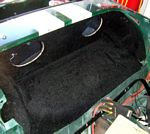 Partially carpeted sprite speaker panel